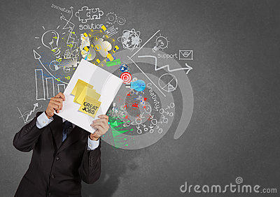 Businessman show great jobs on sticky note with book business st