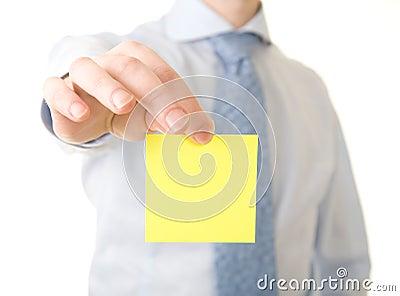 Businessman show yellow reminder
