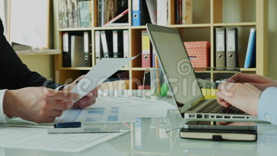 Businessman Showing Financial Results to His Partner in the Modern Office 4K. Businessman Showing Financial Results to His Partner in the Modern Office. Teamwork stock video