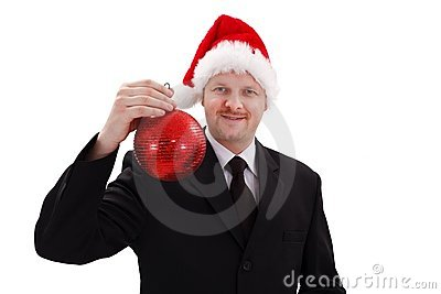 Businessman showing red Christmas ornament