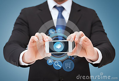 Businessman showing smartphone with blank screen