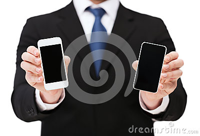 Businessman showing smartphones with blank screens