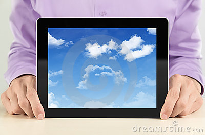 Businessman Showing Tablet PC With Cloudscape
