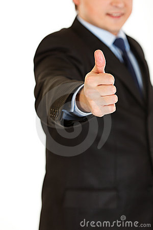 Businessman showing thumbs up gesture. Close-up.