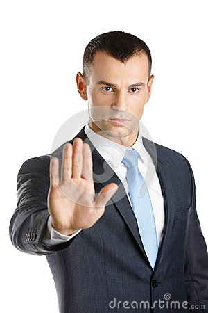 Businessman shows stop gesture
