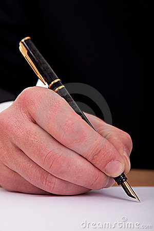 Businessman signing a document  with fountain pen