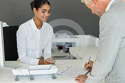 Businessman signing employee sheet Stock Photo