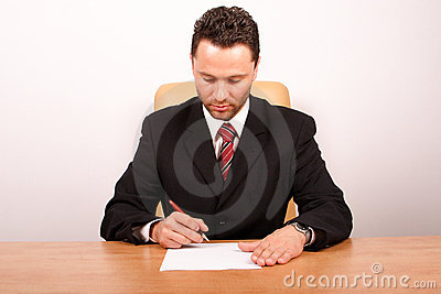 Businessman signing the paper