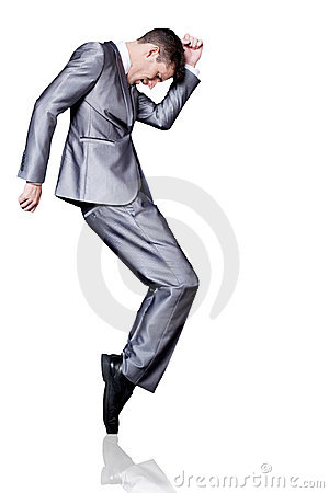Businessman in silver suit dancing. Isolated.