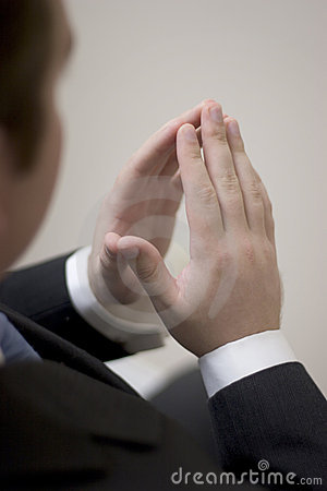 Free Businessman Sits With Hands Together Stock Image - 1475901