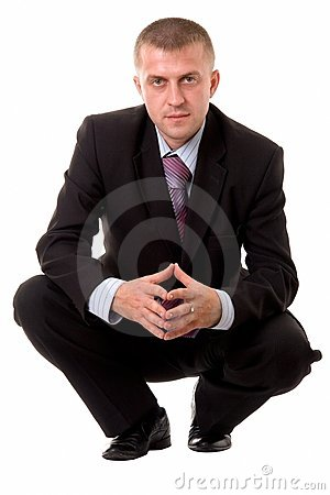 Businessman sitting against white background