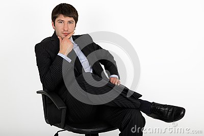 Businessman sitting in an armchair