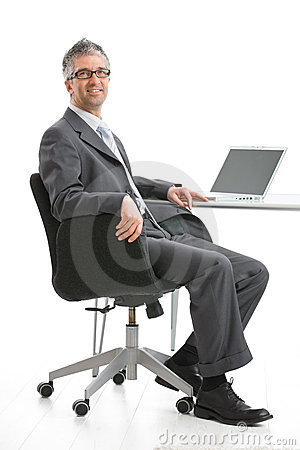 Free Businessman Sitting At Desk Stock Photography - 9935822