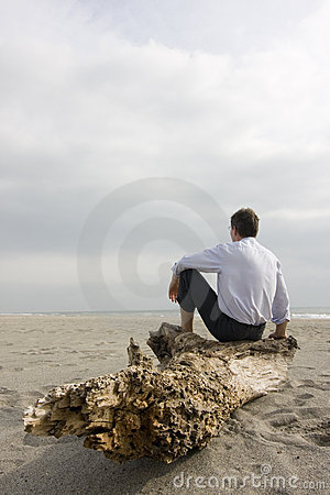 Businessman sitting on beach