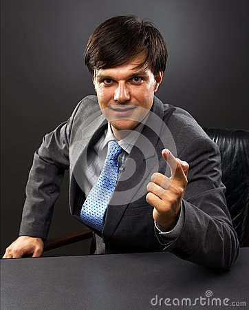 Businessman sitting behind his desk