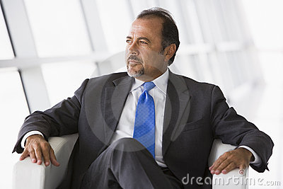 Businessman sitting in chair in lobby