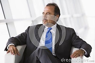 Businessman sitting in chair in lobby