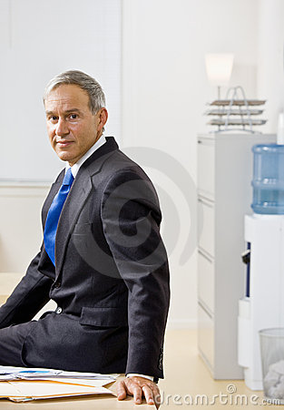 Businessman sitting on desk