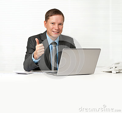 Businessman sitting at desk with laptop