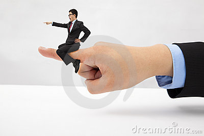 Businessman sitting on the finger  shouting