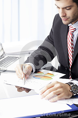 Businessman sitting in front of laptop
