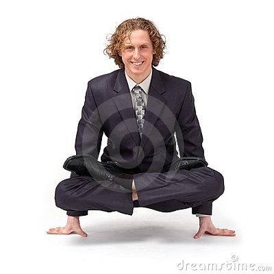 Businessman sitting in full lotus position.