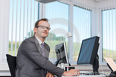 Businessman sitting at his desk thinking