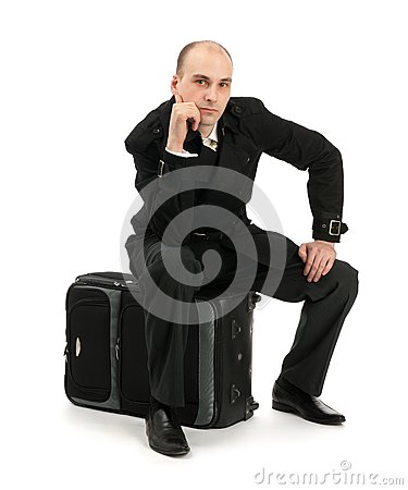 Businessman sitting on his luggage