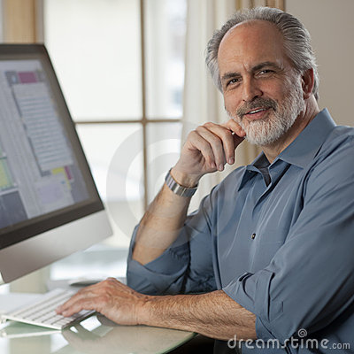 Free Businessman Sitting In Front Of Computer Royalty Free Stock Photo - 13367415