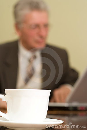 Businessman sitting with  a laptop