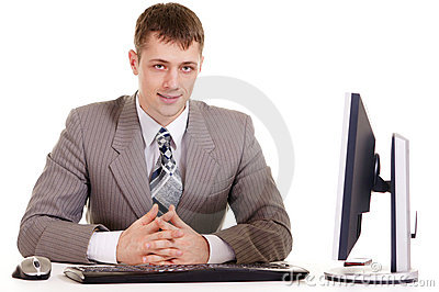 Businessman sitting at a laptop