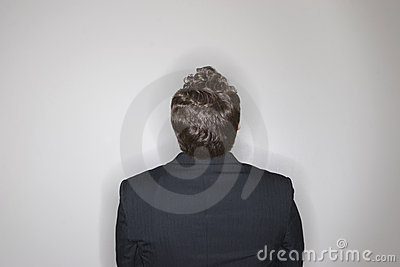 Businessman sitting looking up