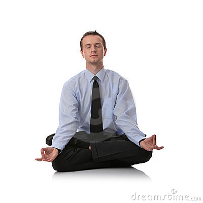 Businessman sitting in lotus position