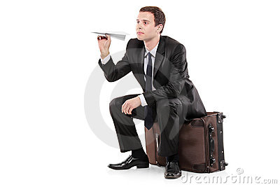 Businessman sitting on a luggage