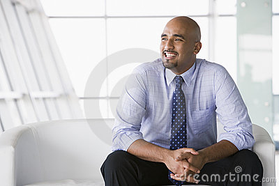 Businessman sitting on sofa in lobby