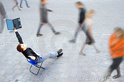 Businessman sitting at the street