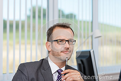 Businessman sitting thinking