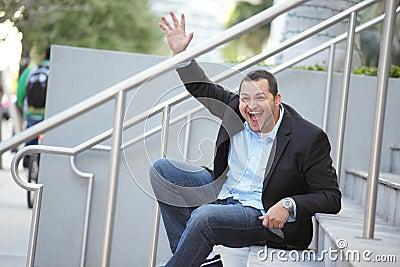 Businessman sitting and waving