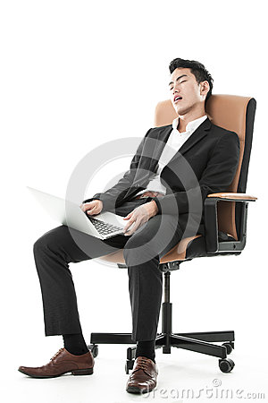 Businessman sleeping on a chair