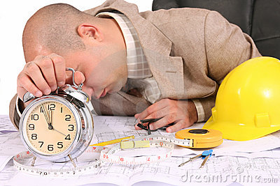 A businessman sleepy with architectural plans