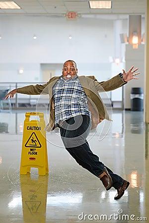 Businessman Slipping On Wet Floor Stock Photo Image