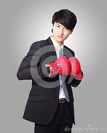 Businessman smile with boxing gloves