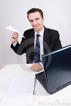 Businessman smile portrait paper plane in office