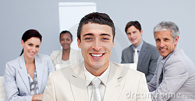 Businessman smiling in a meeting