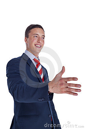Businessman smiling and offering a handshake