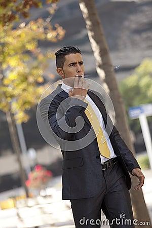 Businessman smoking a cigar