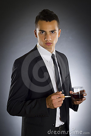 Businessman smoking a cigarette and drinking