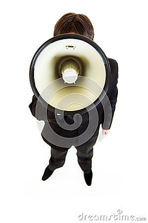 Businessman speaking into megaphone