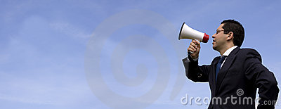 Businessman speaking with a megaphone