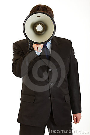 Businessman speaking into megaphone isolated